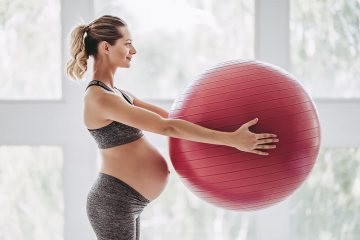 bigstock-Pregnant-Woman-Workout-208495579